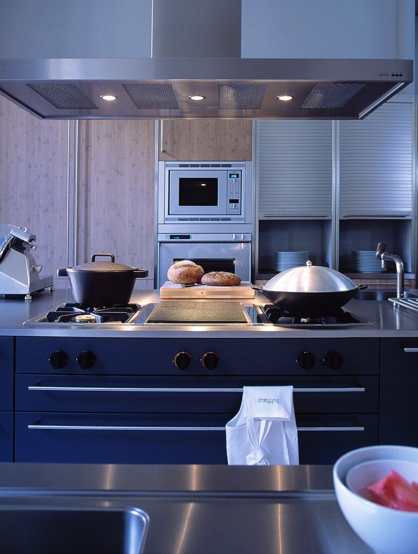 A kitchen with a gas hob and built-in appliances