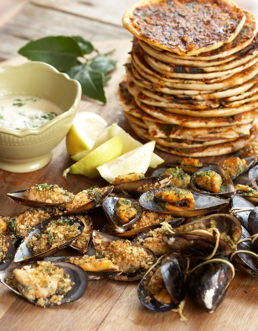 Grilled mussels with lime & coriander butter, toasted pitas with chermoula