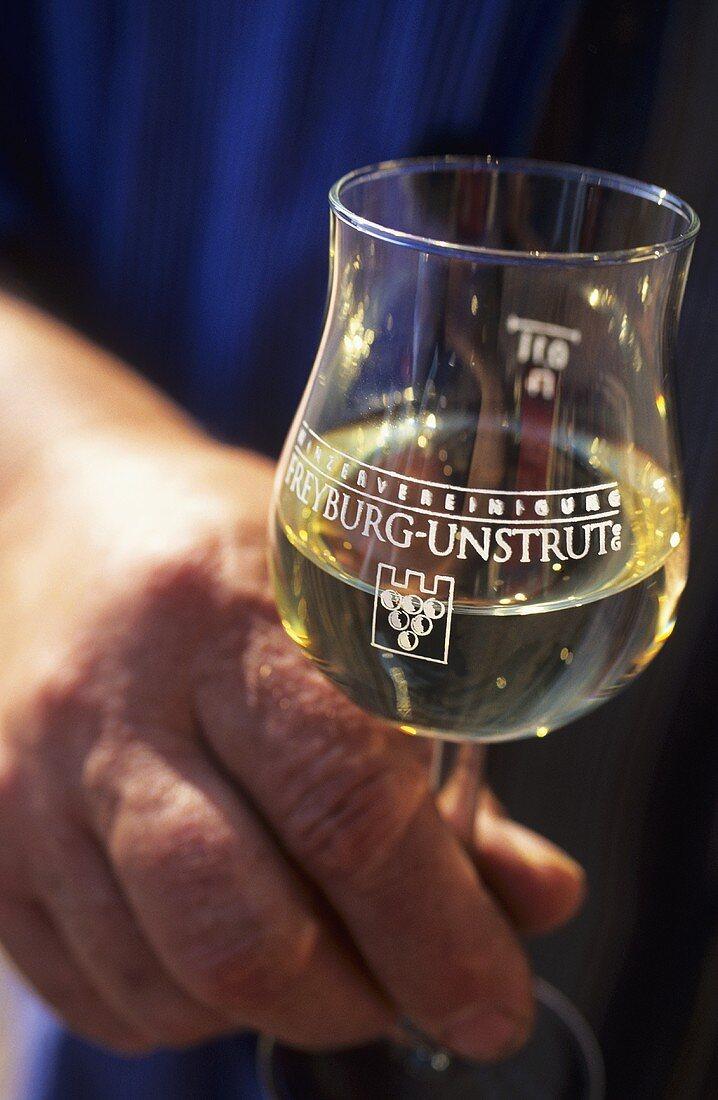 Winemaker with glass of white wine, Winzervereinigung Freyburg-Unstrut, Saale-Unstrut