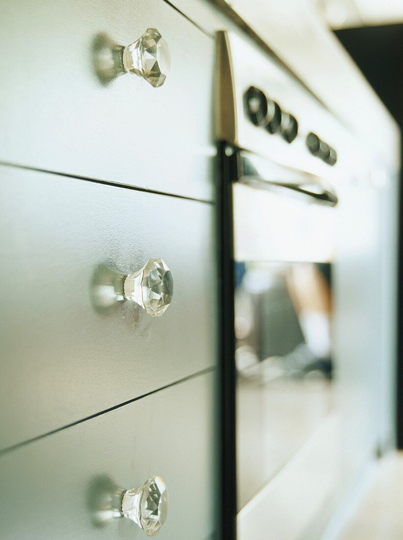 Kitchen drawers with clear, cut acrylic handles
