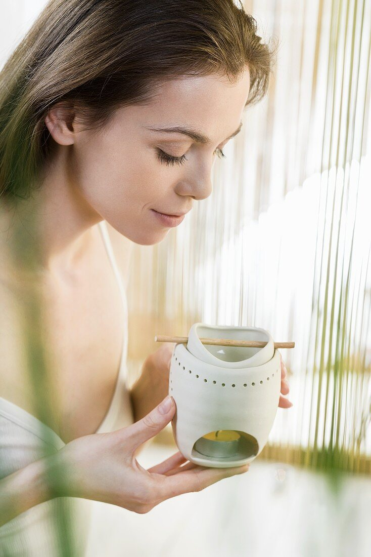 A woman with an oil burner