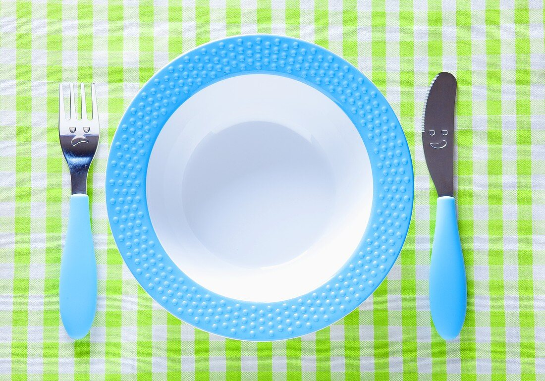 A child's place setting with a plate, knife and fork