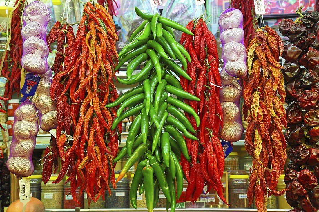A market stall with chilli pepper and garlic (Mercat de St. Josep (Boqueria), Las Ramblas, Barcelona, Spain)