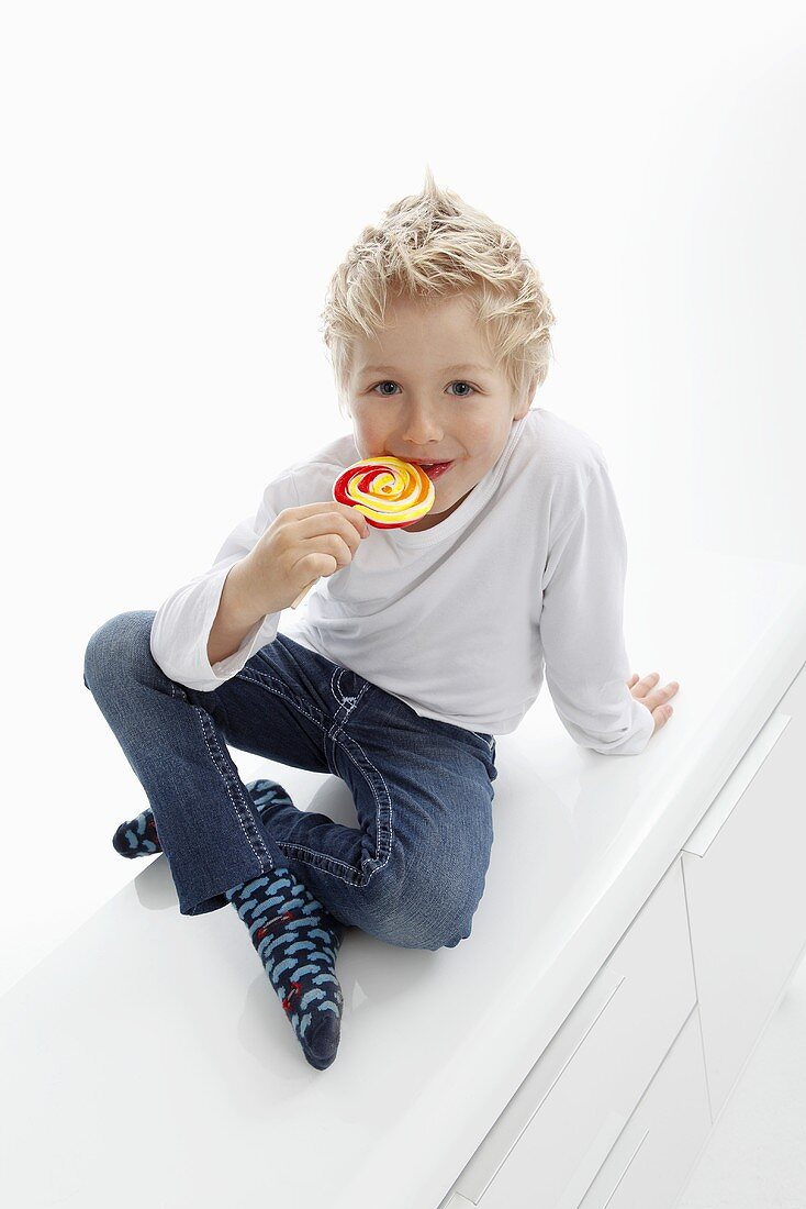 A little boy with a lolly