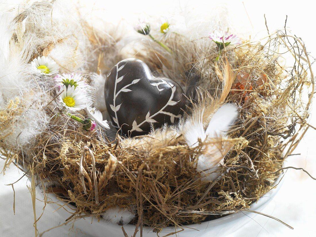 Brown heart in bird's nest