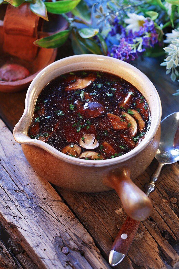 Mushroom soup in ceramic pot