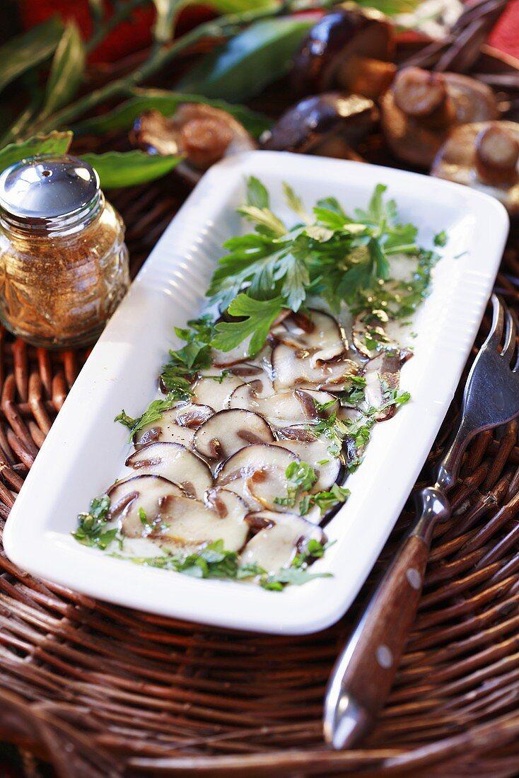 Carpaccio of bay boletes with fresh parsley