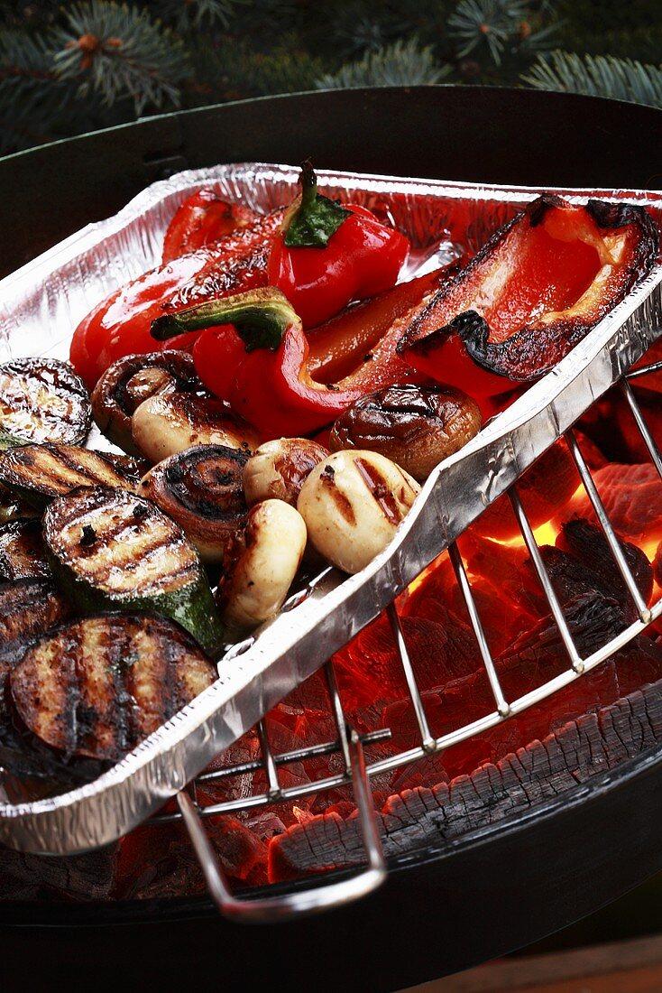 Barbecued vegetables in aluminium dish