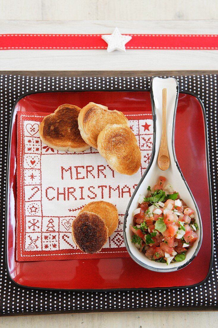 Toast and tomato salsa on festive plate