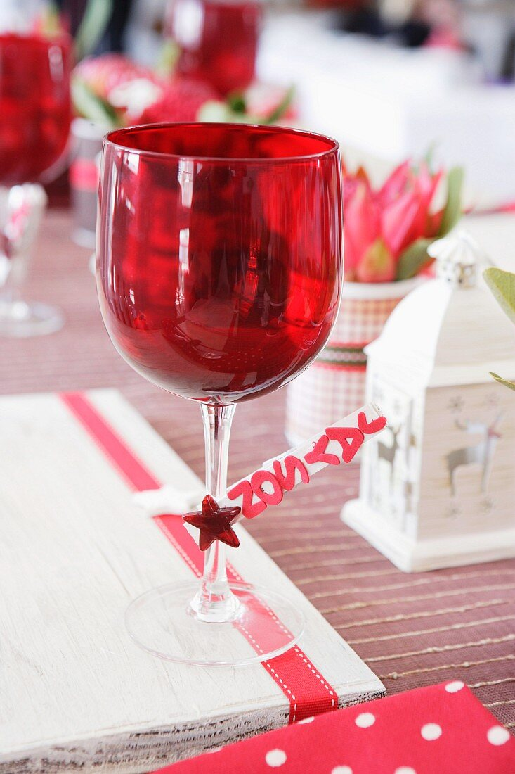 Glass of red wine on a Christmas table