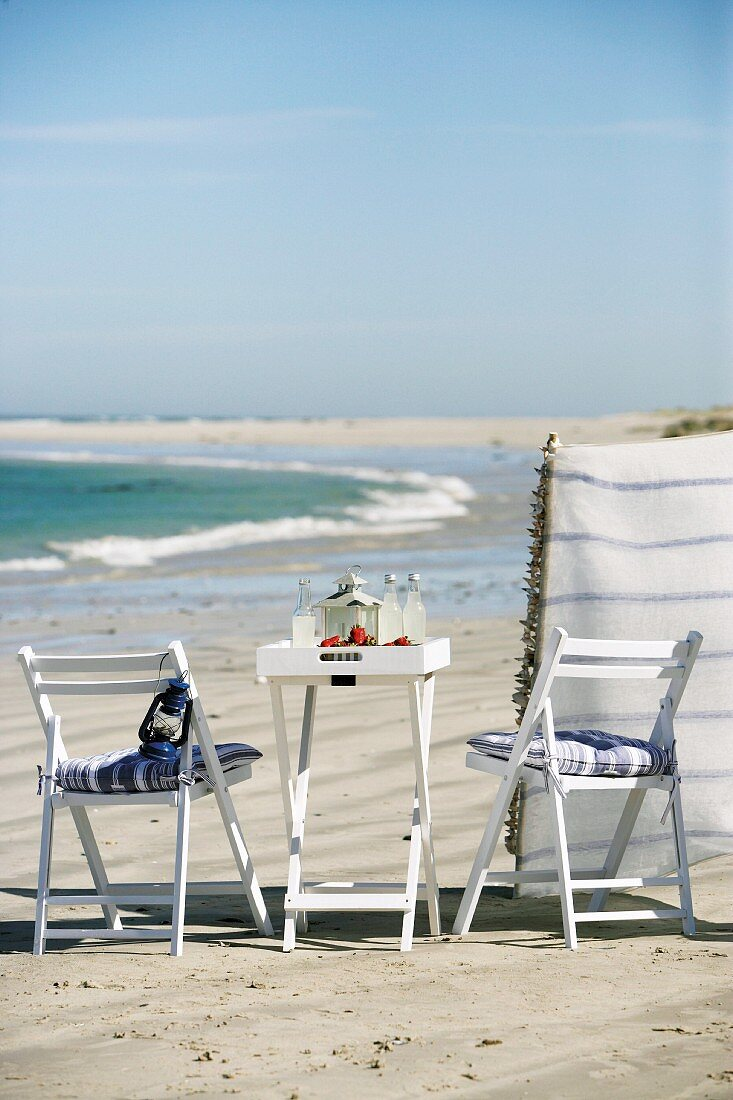 Small breakfast table by sea