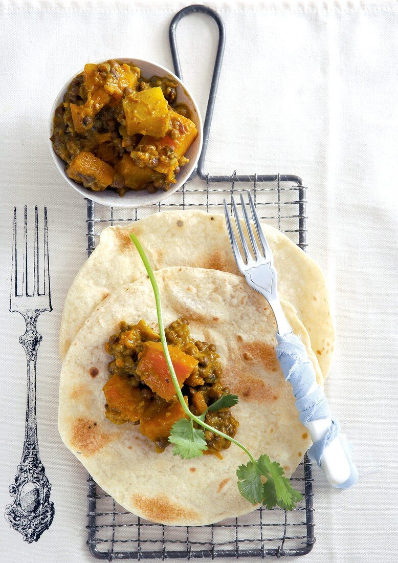 Lentil and pumpkin curry on roti