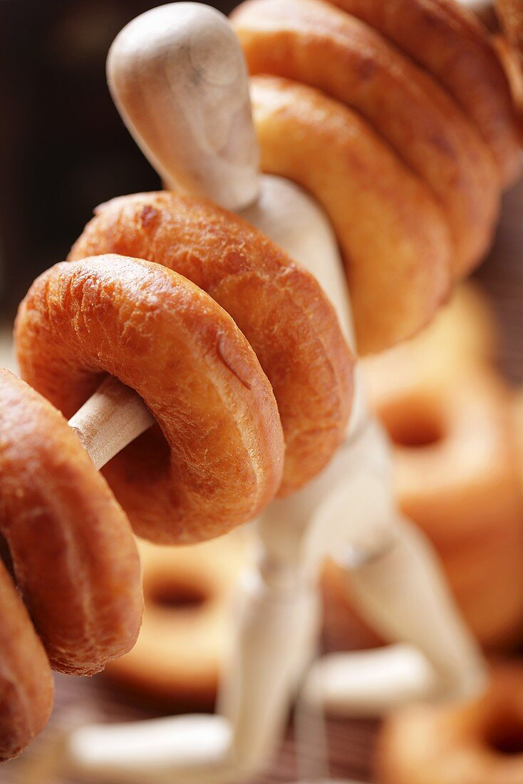 Doughnuts on a wooden figure