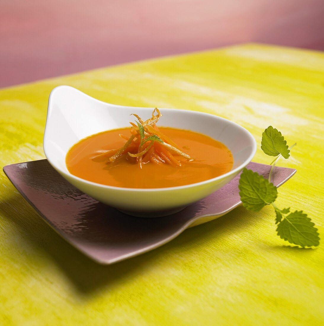 Carrot and lime soup in a soup plate