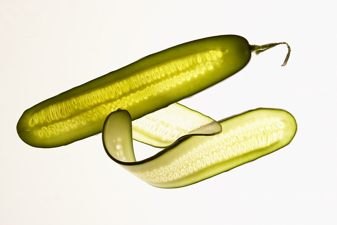 Cucumber and cucumber slices, backlit