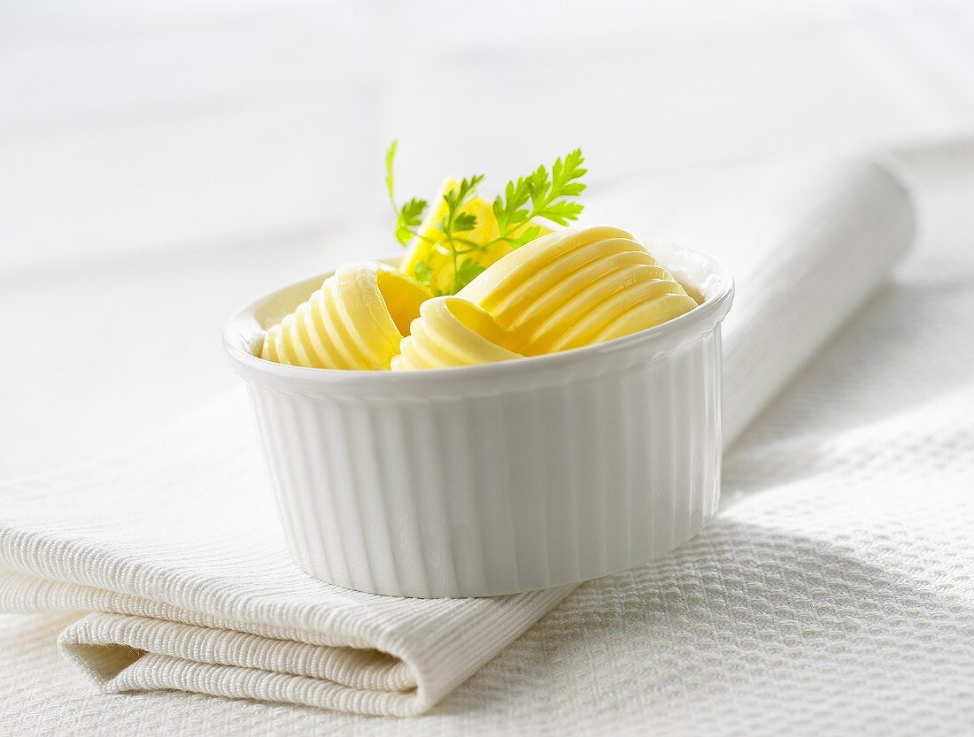 Several butter curls in a small bowl