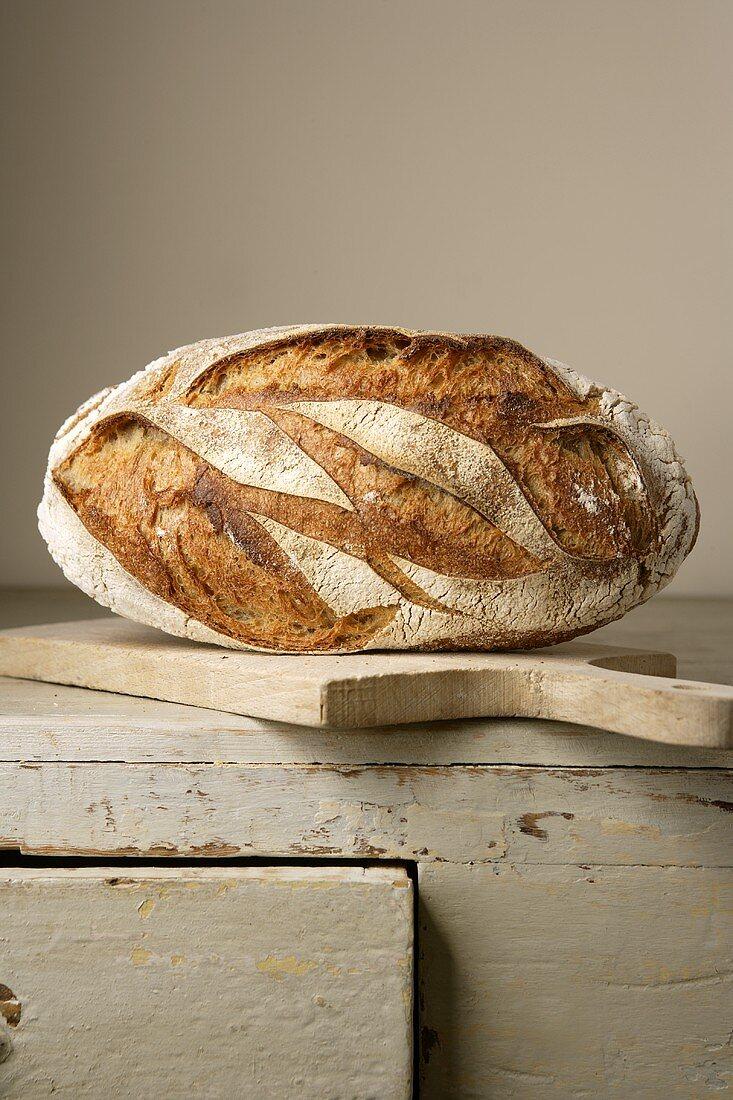 Farmhouse bread on wooden cupboard