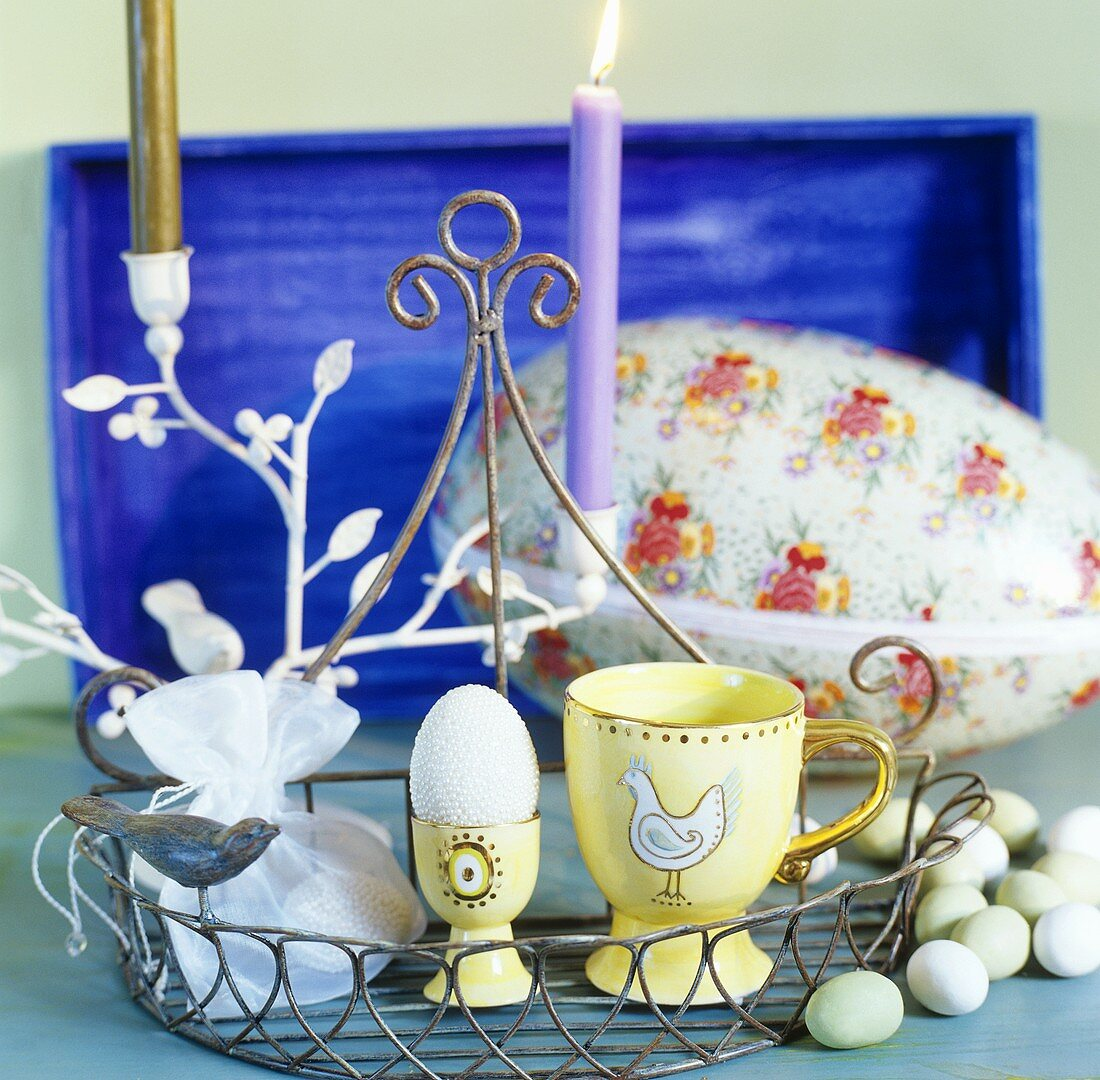 Easter egg with white beads and sugar eggs