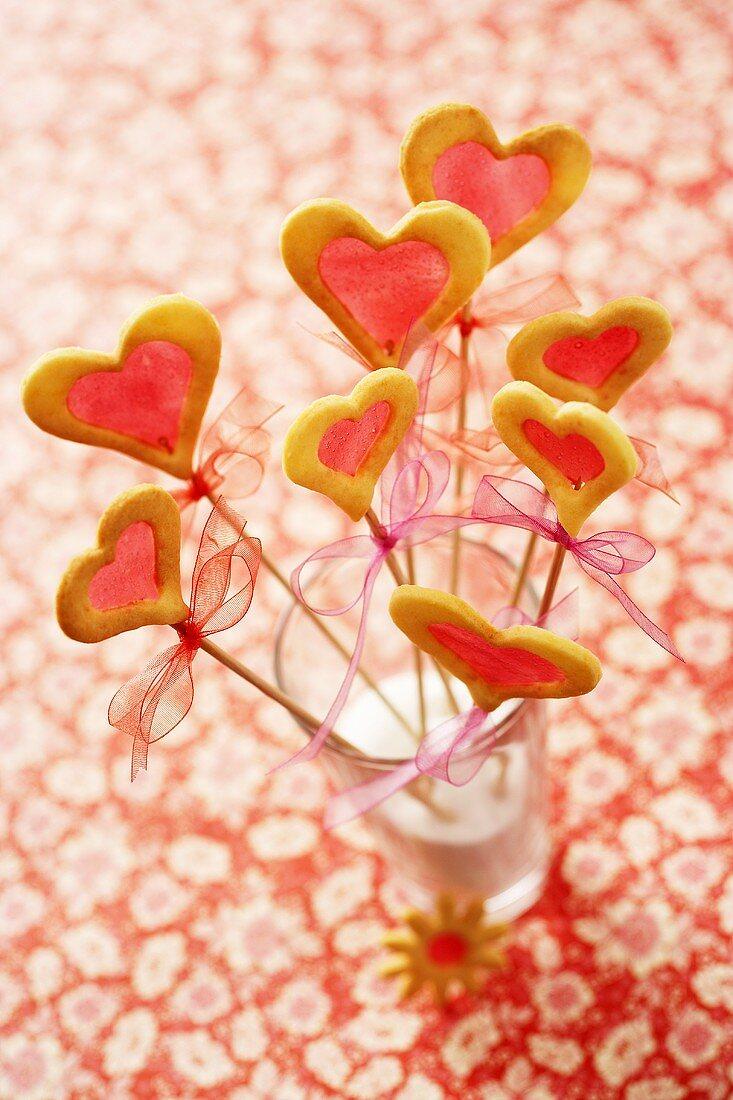 Window cookies (biscuits with sugar 'window') in glass of milk