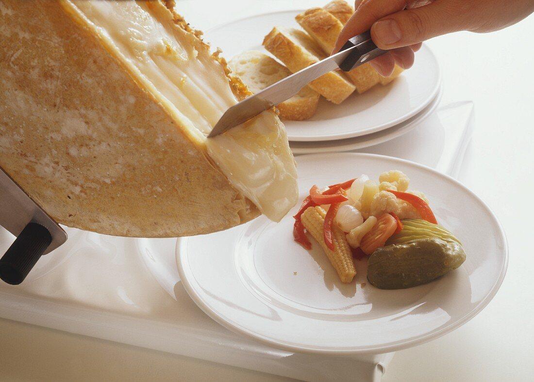 Swiss raclette being scraped