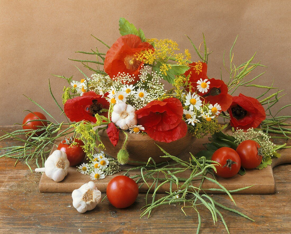 Still life with flowers, herbs and vegetables