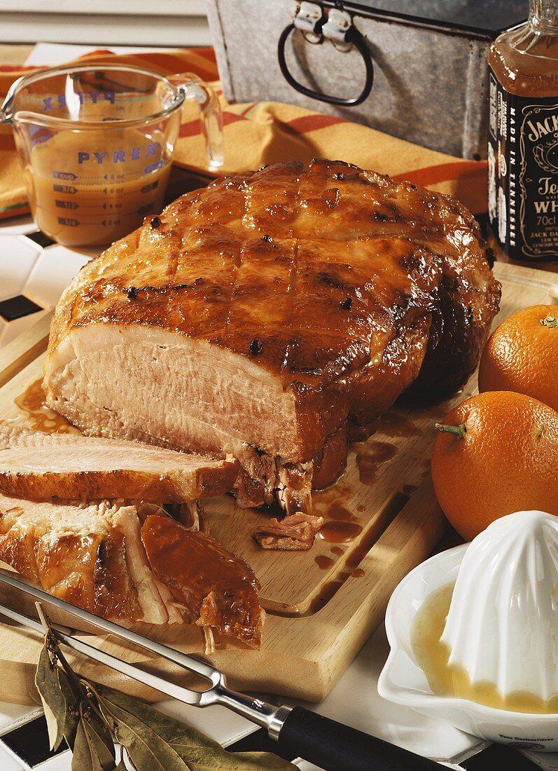 Baked glazed ham, slices carved