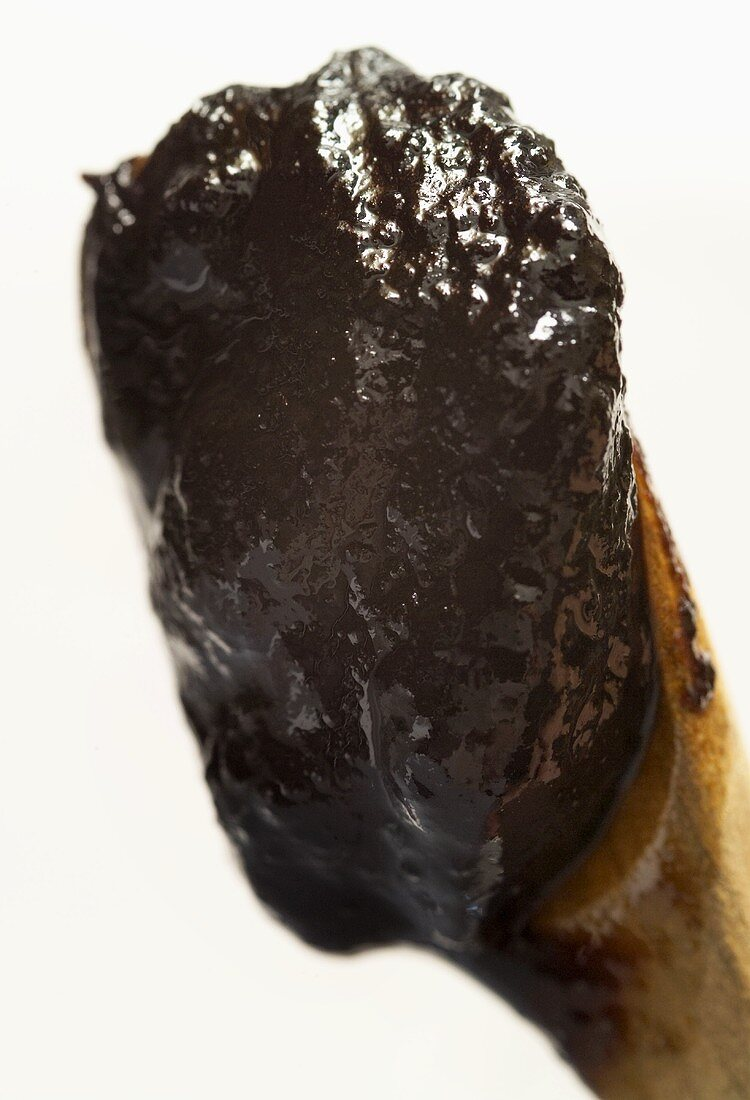 Tamarind paste on a wooden spoon