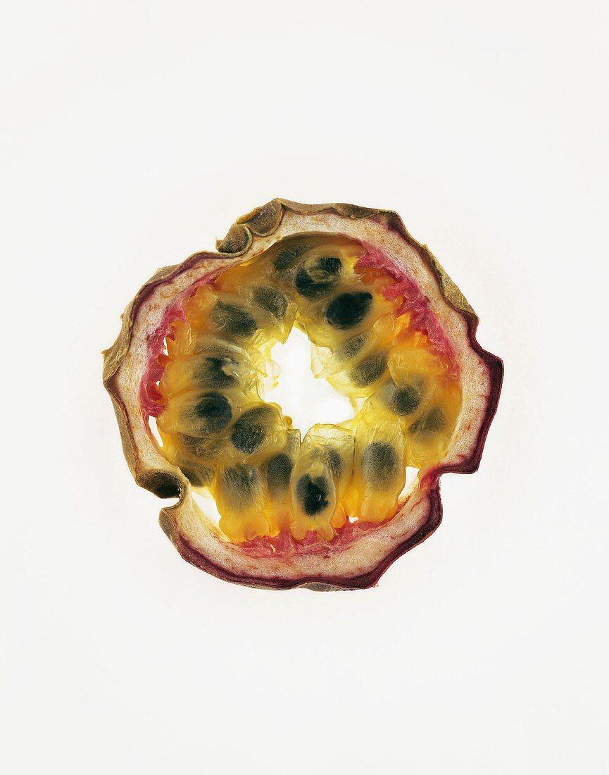 Slice of passion fruit, backlit
