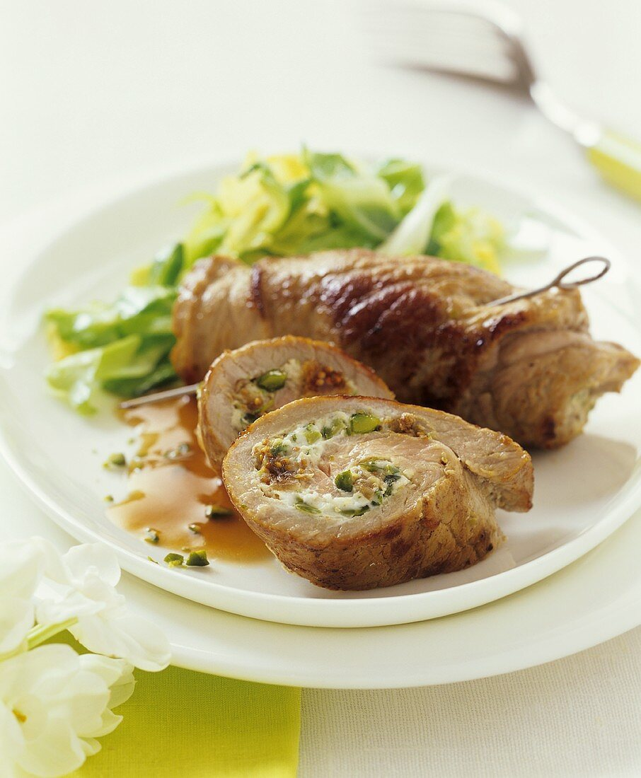Veal roulades filled with pistachio, ham and fig cream