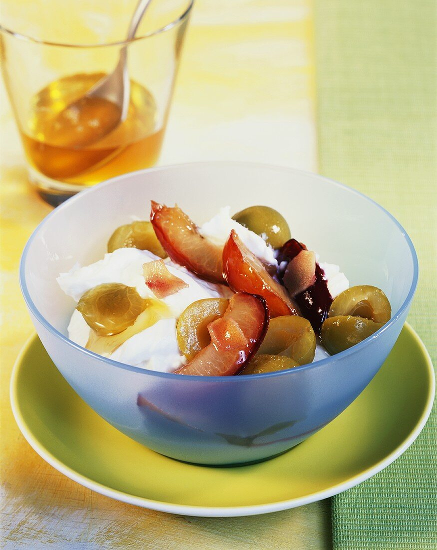 Quark dessert with plums and mirabelles