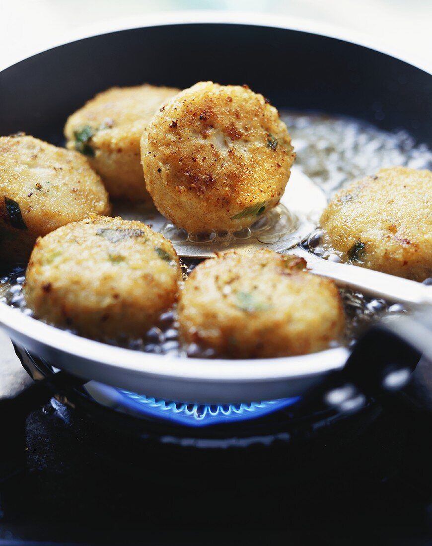 Fish cakes in a frying pan