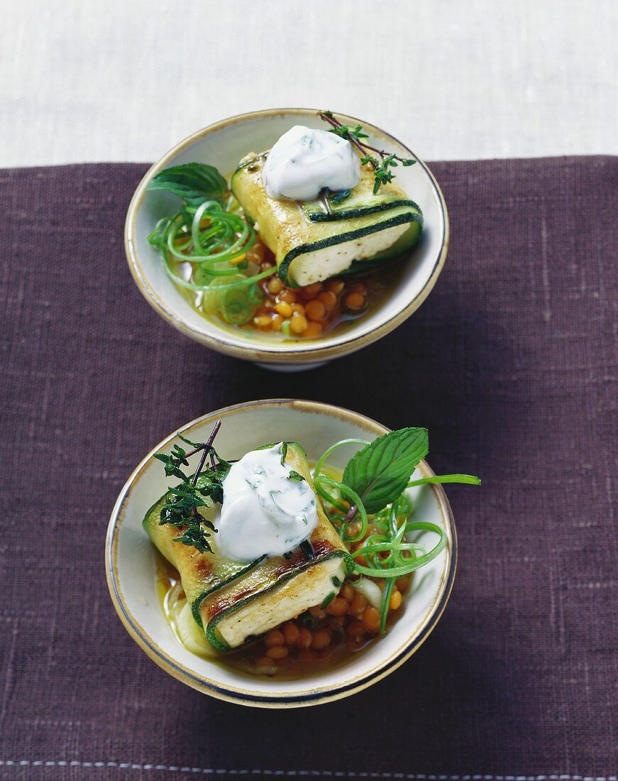 Courgette & sheep's cheese parcels with mint yoghurt on lentils