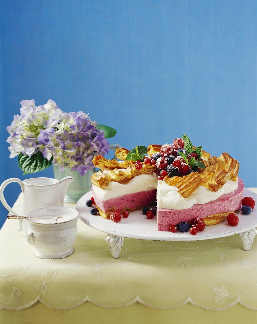 Berry yoghurt cake with cream and choux pastry decorations