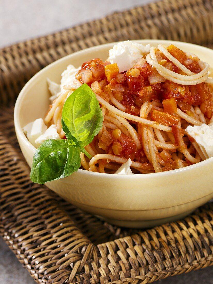Spaghetti with tomato and lentil sauce and feta