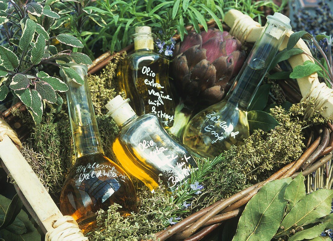 Basket of herbs with bottles of oil and vinegar