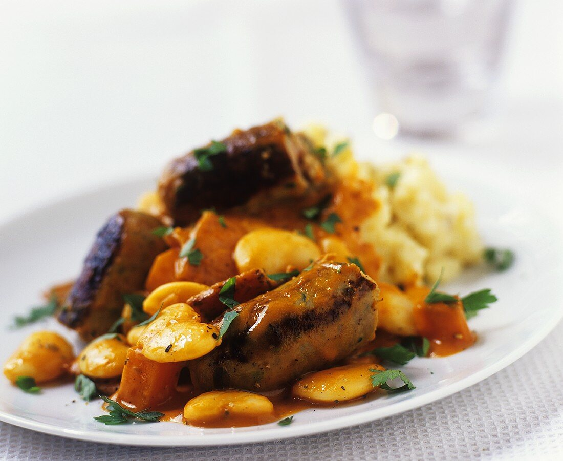 Sausages with white beans and mashed potato