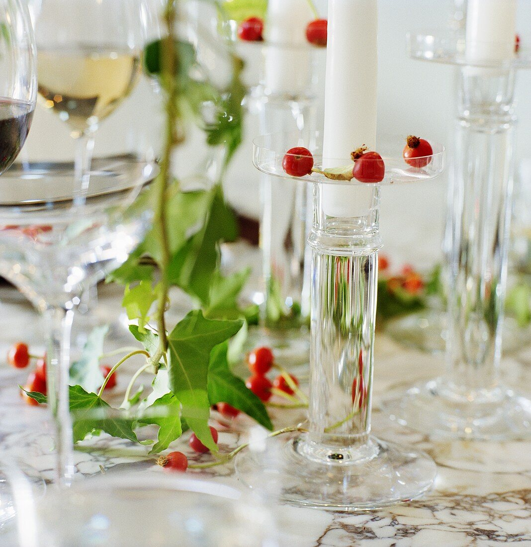 Table decoration of glasses, candles, ivy etc. (detail)