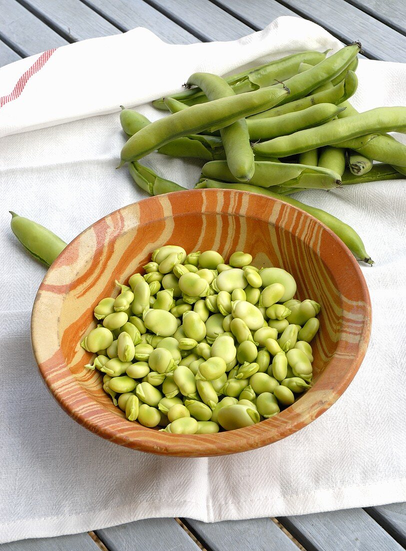 Bowls of Fresh Pea Pods with Peas
