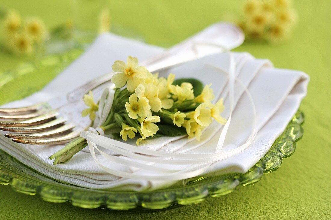 Small posy of cowslips on a napkin