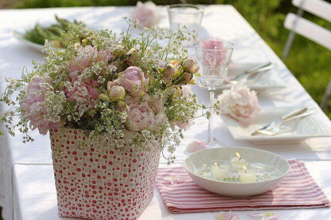 Arrangement of peonies and coriander
