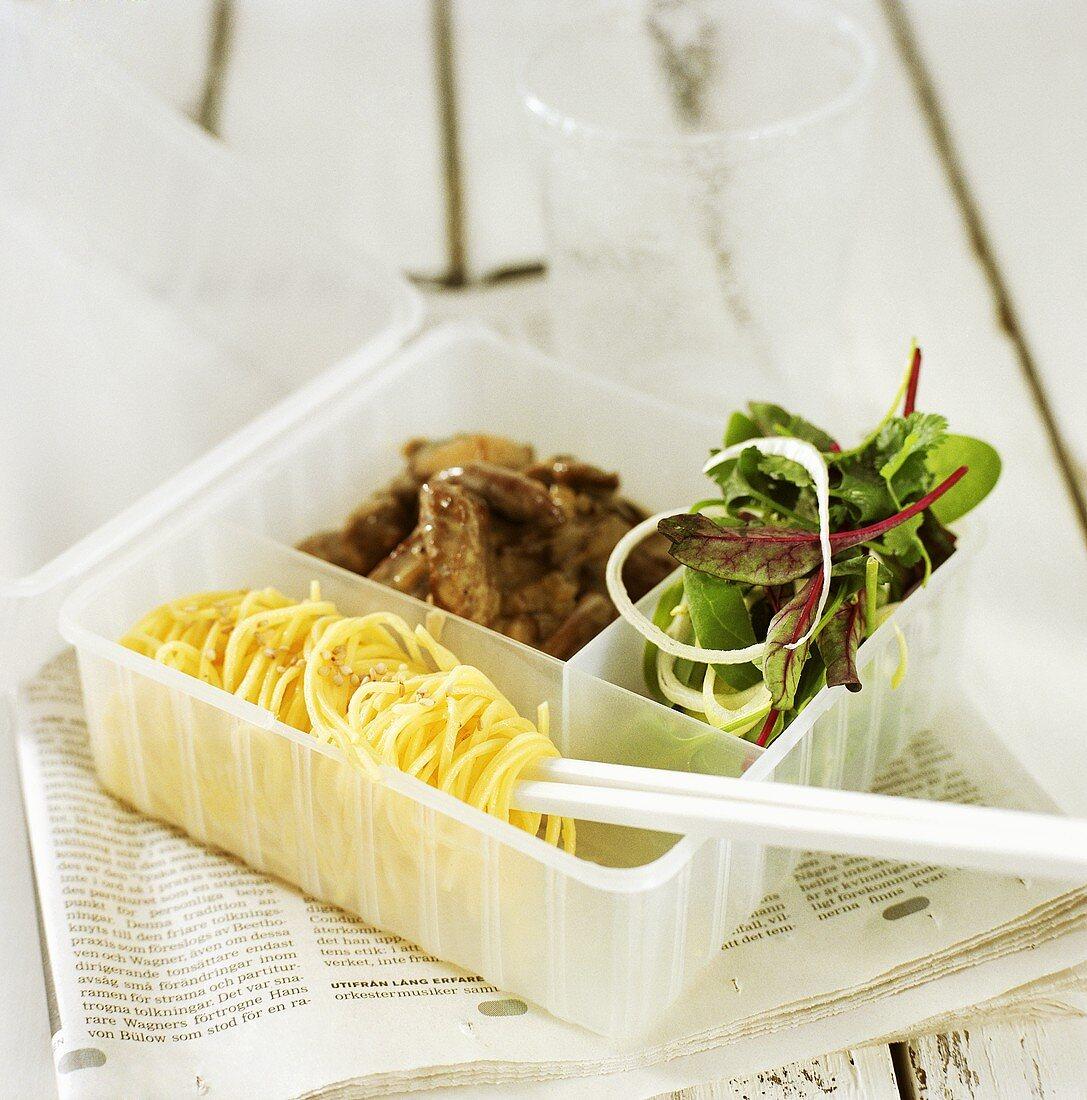 Fried elk fillet with pasta and salad leaves