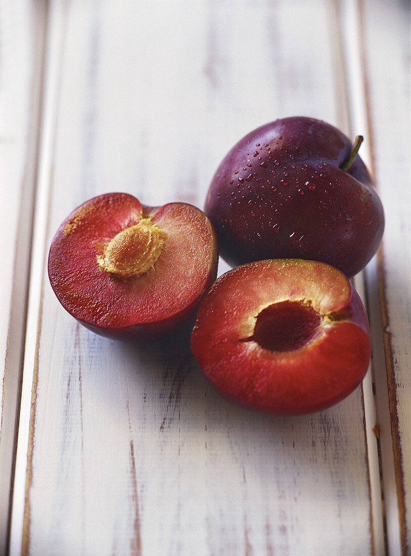 One whole and one halved plum