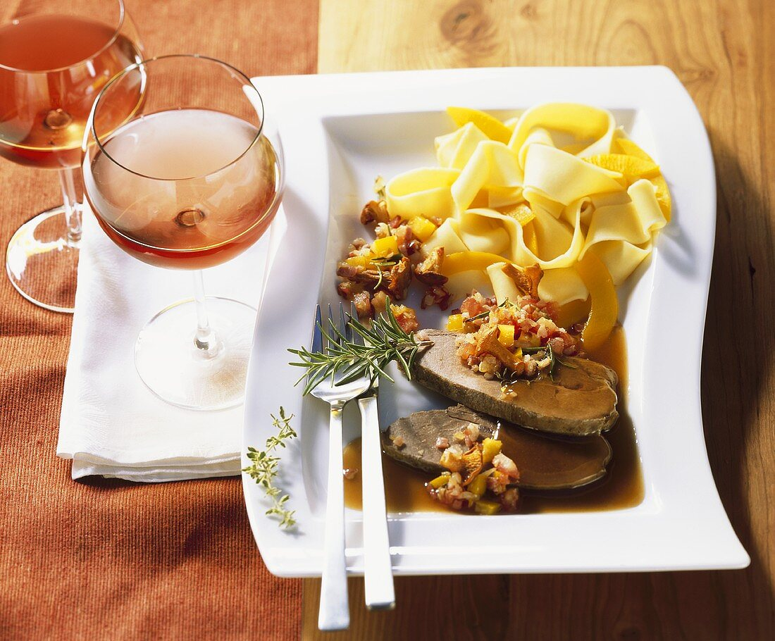 Roast wild boar with ribbon pasta and strips of pumpkin