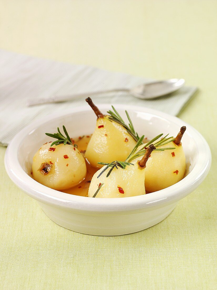Spicy poached pears with rosemary and chili