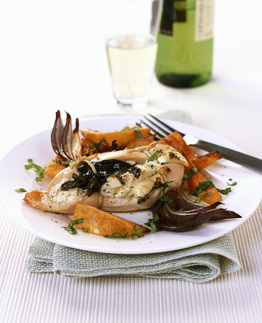 Stuffed chicken breast with baked pumpkin wedges