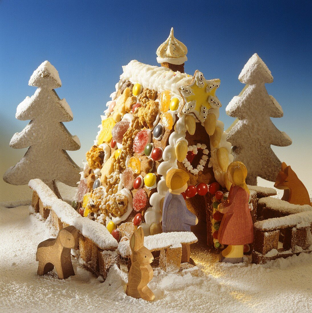Gingerbread house with wooden figures