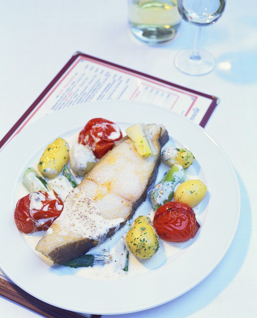 Halibut with Pommery mustard sauce, leeks & stewed tomatoes