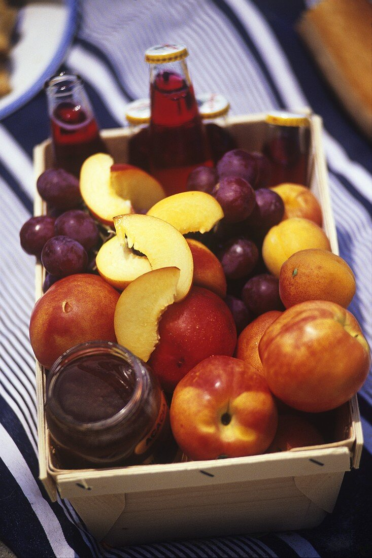Fruit, fruit juice and acacia honey in a basket
