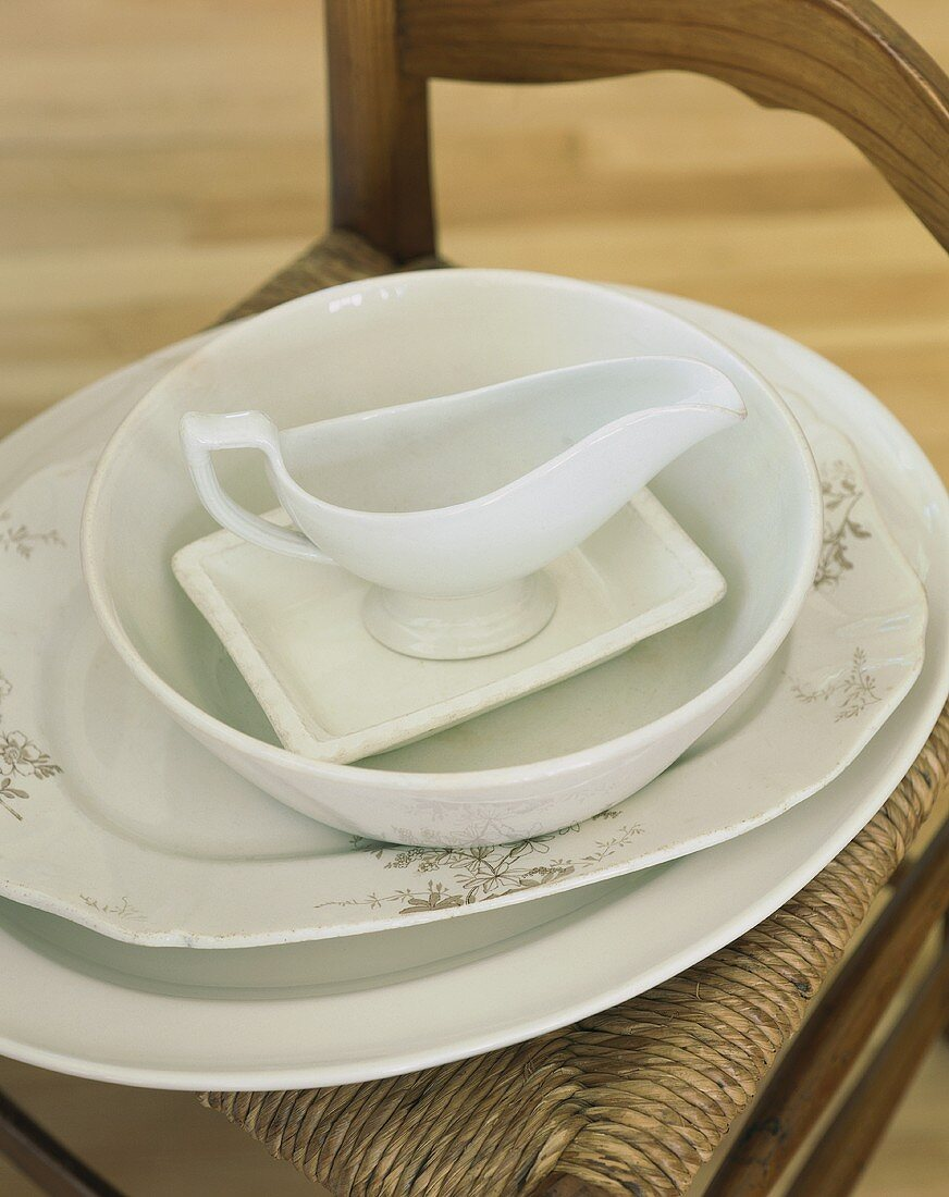 Serving platters and sauce boat on a chair