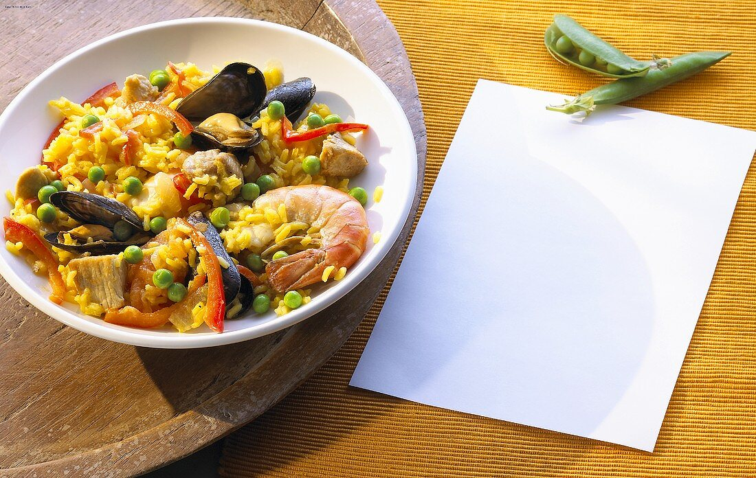 Paella with shrimps and mussels in a shallow bowl